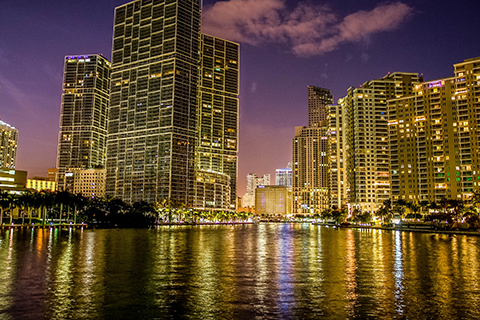 A stock photo of the Brickell skyline at night in Miami, Florida.