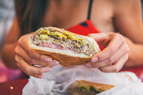 A up close stock photo of a traditional Cuban sandwich.