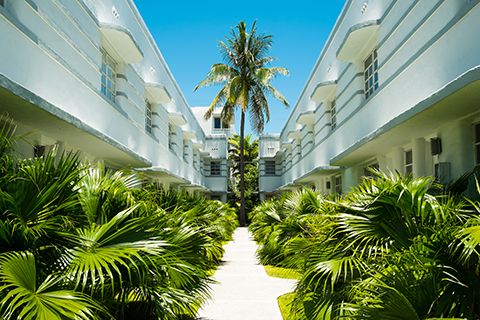 A stock photo of an art deco apartment community in Miami Beach, Florida.