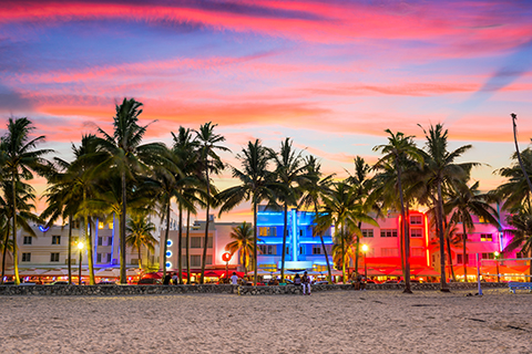 A stock photo of the South Beach skyline at sunset in Miami Beach, Florida.