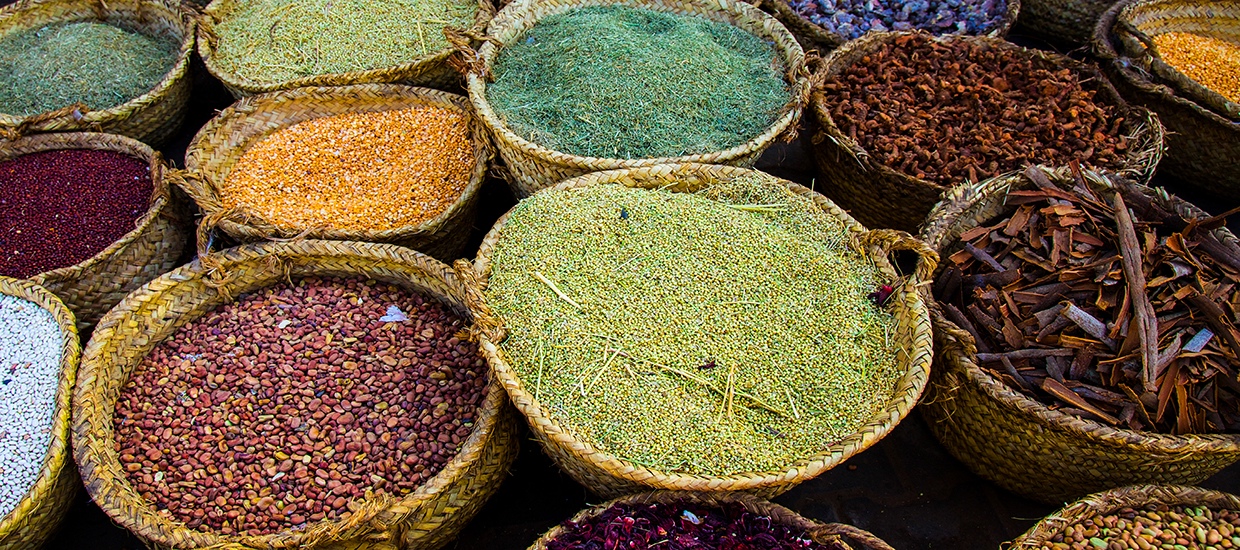 A zoomed in stock photo of spice baskets in a Sudanese spice market.